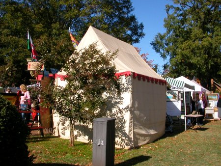 Period tent with internal steel tube frame and no guy ropes.